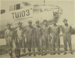 Along with a group of six others, New Orleanian native Russell F. Desvignes graduated from the Tuskegee Field on April 16th 1945. From left to right the Airmen are: F/O James H. Taylor, Champaign, Ill.; 2nd Lt. Lowell H. Jordan, New York, NY; F/O Leroy Criss, Los Angeles, Calif.; F/O George G. Norton, St. Louis, Mo.; 2nd Lt. Theopolis W. Johnson, Birmingham, Ala.; F/O Russell F. Desvignes, New Orleans, La.; F/O Eldridge Freeman, Chicago, Ill. (Official U.S. AAF Photo by AAF Training Command.)