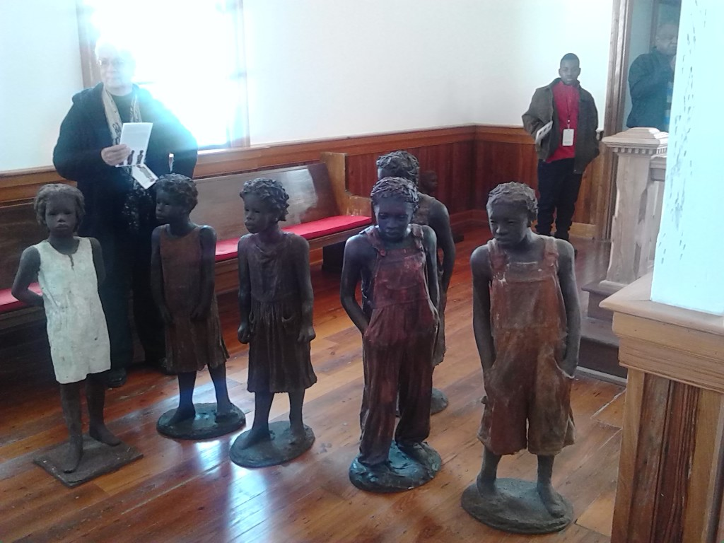 Enslaved children sculptures in the church
